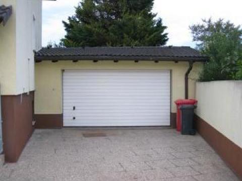 Porti de garaj mediu rezidential de la Rollux Construct