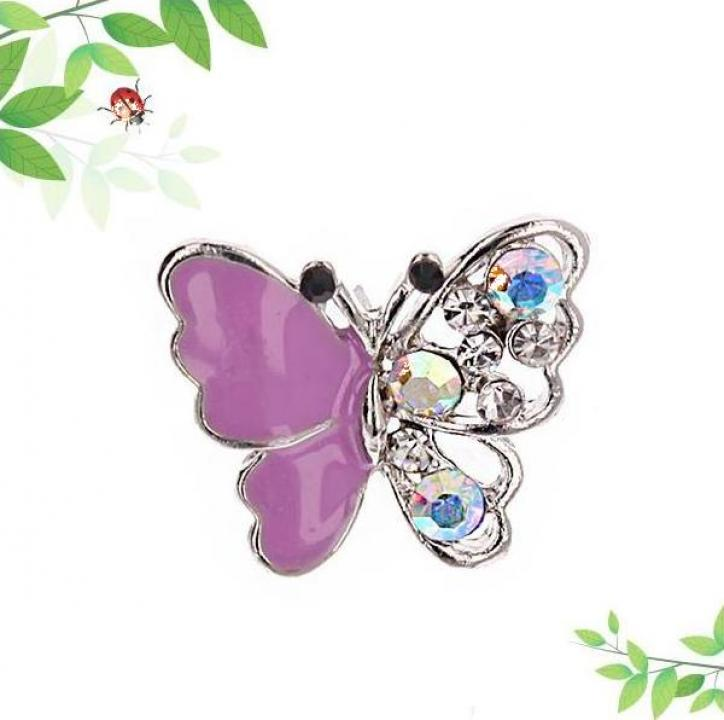 Brosa bijuterie in forma de fluturas